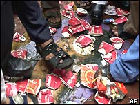 Activists of Samajwadi Party crush paper cups of Pepsi and Coca Cola at a protest in Bombay