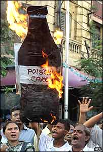 Indian protestors burn a placard depicting a bottle of Cola during a demonstration in Calcutta