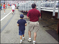 Father with his son at Nascar race