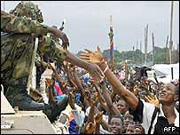 Crowds greeting West African peacekeepers