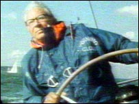 Edward Heath at the wheel of a yacht