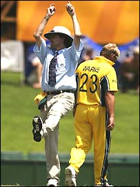 Billy Bowden signals a six in his own inimitable style as Shane Warne returns to his mark at the World Cup