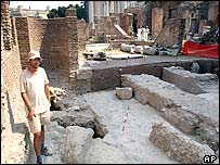 An unidentified man amidst the ruins of Caligula's palace at the Forum in Rome