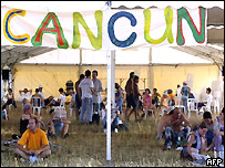 French anti-globalisation protesters sit in front of a tent named Cancun