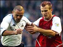 Tottenham's Steven Carr battles with Freddie Ljungberg of Arsenal