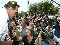 Arnold Schwarzenegger speaking to journalists