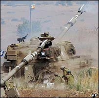 Israeli tanks firing at Hezbollah positions