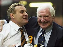 Wolves chairman Sir Jack Hayward celebrates promotion with manager Dave Jones