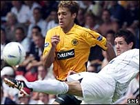 Gary Mason clears from Celtic's Stilian Petrov