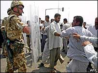 An Iraqi civilian vents his frustration at a British soldier in Basra
