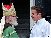 Archbishop Sean O'Malley, left, greets Gary Bergeron, an alleged victim