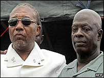 Charles Taylor (L) with his successor, Moses Blah