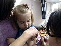 Child being immunised