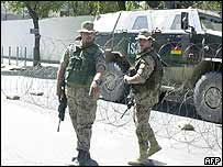 Two German soldiers from the International Security Assistance Force (Isaf) stand guard outside UN offices in Kabul