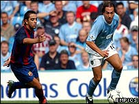 Manchester City's Eyal Berkovic turns away from Barcelona's Xavi