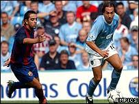 Manchester City's Eyal Berkovic turns away from Barcelona's Xavi