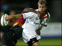 Ulster wing Scott Young hangs on to possession