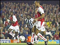 Thierry Henry scores from the spot in Arsenal's 3-2 win over Newcastle