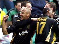 Henrik Larsson celebrates his winner