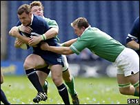 Gordon Bulloch is tackled by Ireland's Brian O'Driscoll