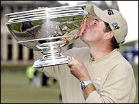 Westwood kisses the trophy after his victory