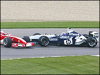 Juan Pablo Montoya's Williams collides with Rubens Barrichello's Ferrari