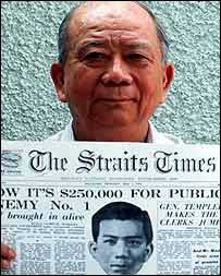Chin Peng holds 1952 newspaper offering reward for his capture
