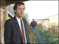 Leslie Grantham as Den Watts 