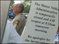Sign on doors on Maryland Motor Vehicle Administration, AP