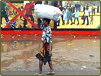 Sack of food being carried in the port area of Monrovia
