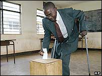 Disabled voter casts his ballot on Monday