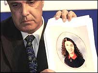 Commander Andy Baker with a school portrait of honour killing victim Heshu Yones