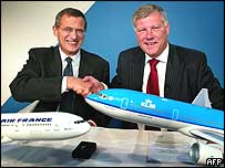 KLM and Air France chief executives shake on the deal