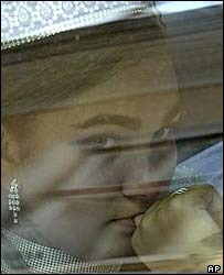 Ana-Maria sitting in car after her wedding