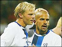 Eidur Gudjohnson (left) celebrates his goal with Juan Veron