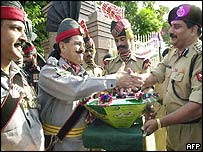 Pakistani border guards hand sweets to Indian counterparts at Wagah crossing on independence day
