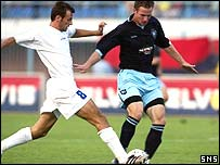 Steve Lovell battles for possession in Albania