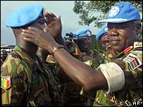 West African peacekeeper puts on UN blue beret