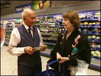 An older worker in a supermarket