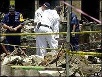 Investigators search the site of the Bali bomb