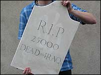 The other side of the gravestone bears a memorial to those killed in Iraq