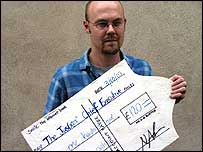 Nick Buxton with the cheque