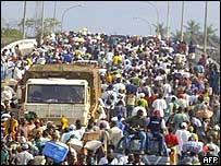 People crossing the bridge in Monrovia