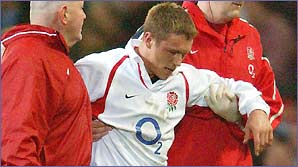 England fly-half Jonny Wilkinson is helped from the pitch in his side's Six Nations win against Wales