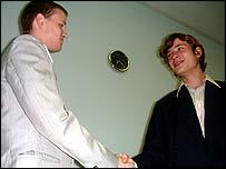 Sergei shakes hands with Nikolai