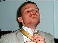 Sergei ties his tie