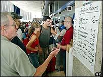 A handwritten list of flights replaces electronic flight information boards