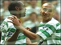 Didier Agathe and Henrik Larsson celebrate at Celtic Park