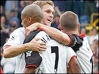 Steve Marlet is congratulated by his Fulham team-mates