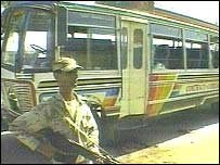 Guard stands by bus after attack in Karachi